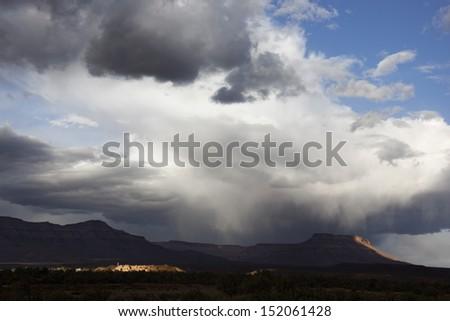 Stormy sky with mountains, Sahara desert, Morocco.  - stock photo