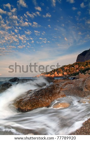 Stormy sunrise on the coast of tropical sea - stock photo