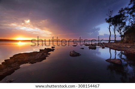 Stormy sunset over the serene waters of St Georges Basin, Sanctuary Point, Australia