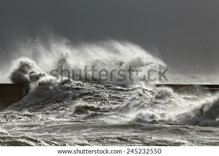 Stormy wave against pier, north of Portugal - stock photo