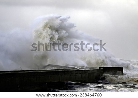 Stormy wave over pier, north of Portugal - stock photo