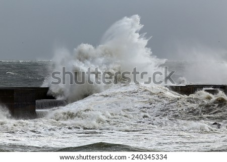 Stormy waves over pier. North of Portugal.