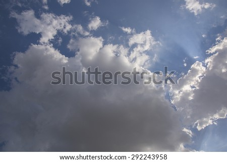 Stormy weather cloud formation and sky'sblue sky with white clouds backlite. - stock photo
