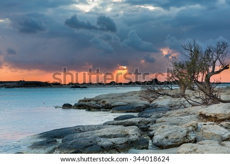 Stormy weather during sunset - stock photo