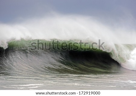 stormy weather on rough sea with big wave breaking - stock photo