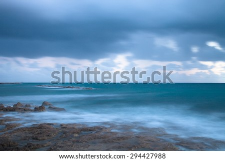 Stormy weather on the coast. Long exposure  - stock photo