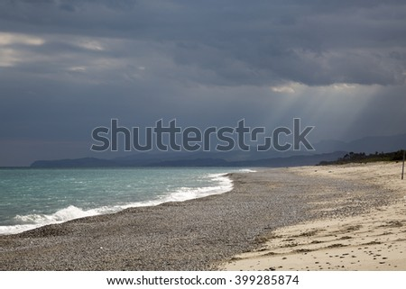 Stormy weather over a Calm blue Sea. Tyndall Effect on the background.