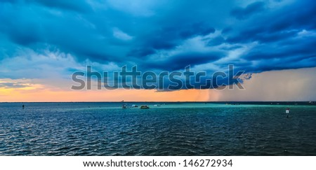 stormy weather over florida with thunder and lightning - stock photo
