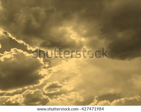 Stormy weather with dark clouds over  sky vintage sepia