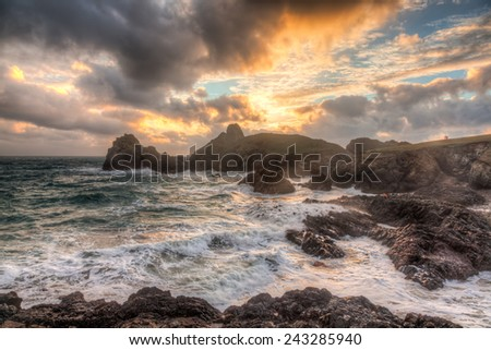 Stormy winters sunset at Kynance Cove on the coast of Cornwall England UK Europe - stock photo