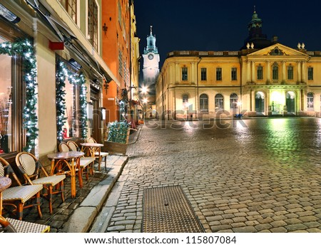 Stortorget with part of Stock Exchange Building and Storkyrkan on background   at night, Stockholm, Sweden. - stock photo