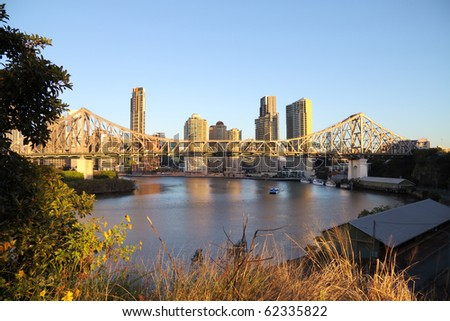 Story Bridge and the Brisbane city skyline in Australia in the early morning light. - stock photo