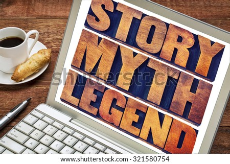 story, myth, legend word abstract - storytelling concept -  collage of words in vintage letterpress wood type printing blocks on a laptop screen with a cup of coffee - stock photo