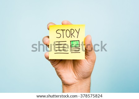 "Storyteller. One hand showing a yellow note with a big title ""story"" on blue background. Useful for digital marketing or inboud marketing."