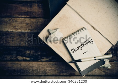 Storytelling word on pages sketch book on wood table vertical