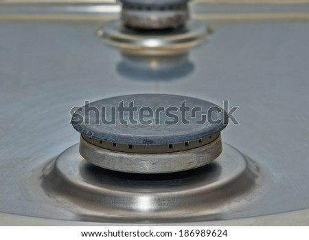 Stove burner cooking gas without gas. Closeup shot. - stock photo
