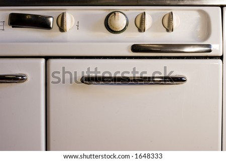 stove front with dials - stock photo