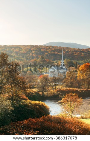 Stowe morning in Autumn with colorful foliage and community church in Vermont - stock photo