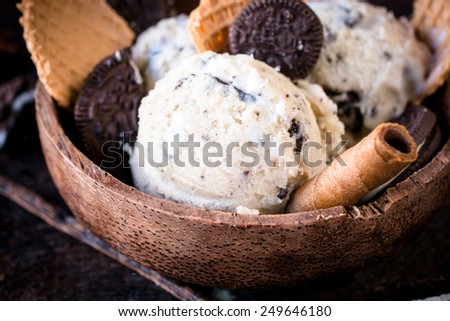Stracciatella homemade ice cream and cookies in the wooden bowl,selective focus - stock photo