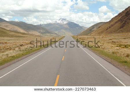 Straight and beautiful rocky road in highland Peruvian Andes