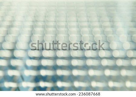 Straight and symmetric row of blurred lights - stock photo