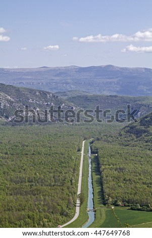 Straight cord -  Street and river  through the Mirna Valley towards Cikarija mountains - stock photo