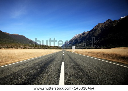Straight empty highway in New zealand - stock photo
