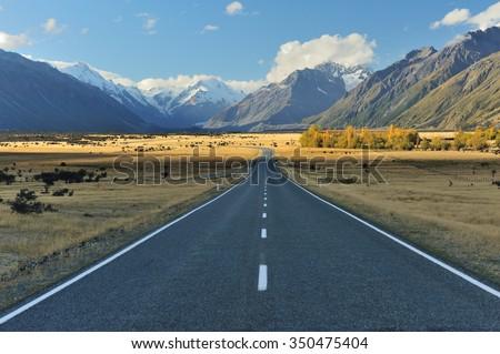 Straight empty highway leading into Aoraki-Mount Cook - stock photo