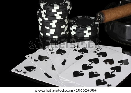 straight flush with poker chips on black background close-up - stock photo