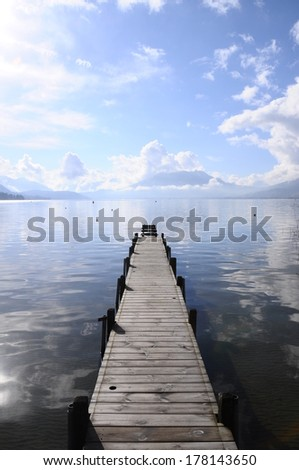 Straight Pontoon Annecy lake and mountains on winter morning - stock photo