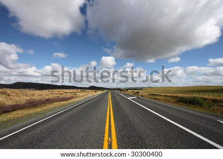 Straight road and beautiful clouds in New Zealand - North Island