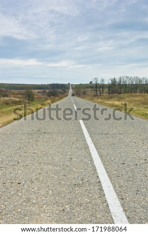 Straight road at cloudy autumn day before the rain, north Serbia - stock photo