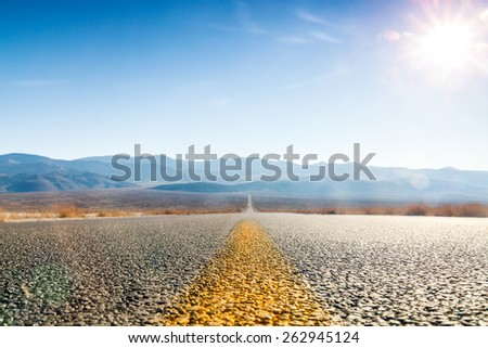 Straight road through Death Valley, California, USA - stock photo