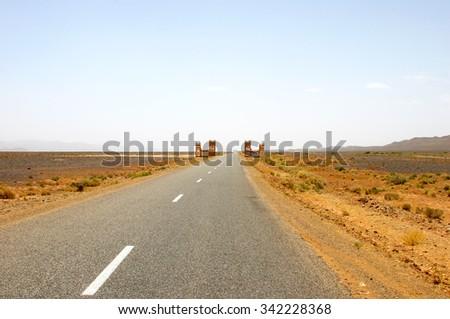 straight road through the desert, Morocco - stock photo