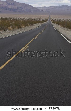 Straight Road to a Horizon in Death Valley National Park in California, USA