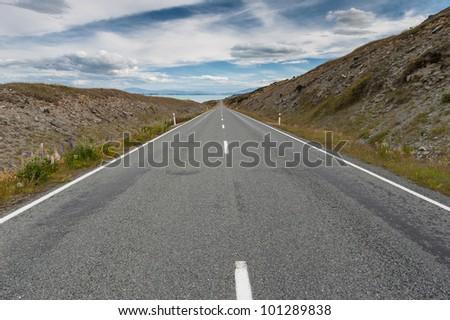 Straight, roadbeside Lake Pukaki, New Zealalnd - stock photo