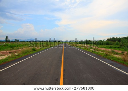 Straight roadway in a sunny day - stock photo