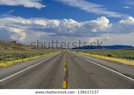 Straight roadway leading on forever in Cokeville, Wyoming, USA