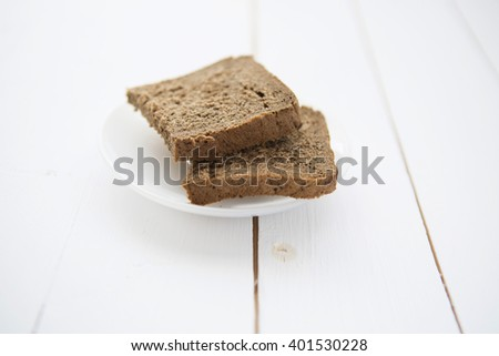 Straight rye bread on white wooden table - stock photo