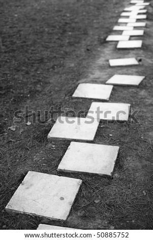 Strait path made of marble stepping stones