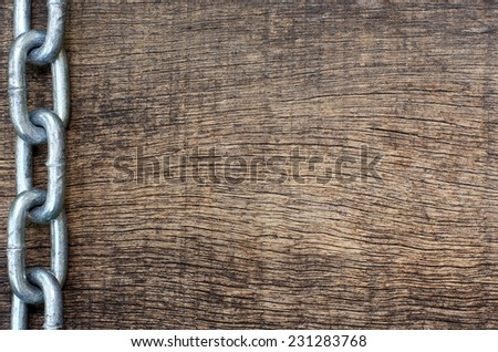 strand iron chain on old wooden background - stock photo