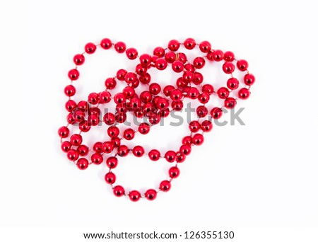strand with red beads over white background