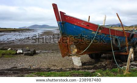 Stranded boat in Kerry, Ireland - stock photo