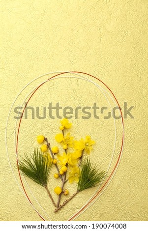 Strands of red and white rope encircle yellow flowers. - stock photo