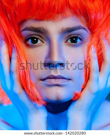 strange beautiful girl in a red wig - stock photo