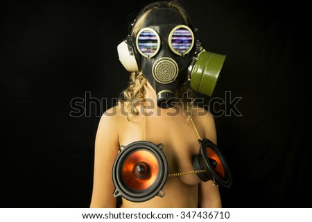 strange gas mask disco gogo dancer with audio speakers covering breasts