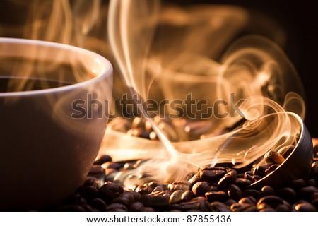 Strange golden smoke taking away from coffee seeds - stock photo