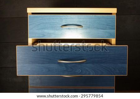 Strange light from drawer - stock photo