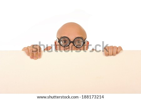 strange looking nerd bald business man wearing geek glasses holding a white blank sign for copy space , adding text , logo or an advertisement isolated on a white background - stock photo