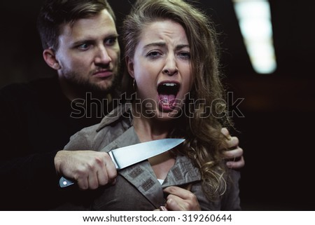 Strange man is threatening to kill young woman